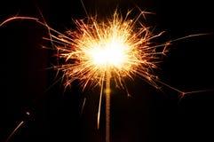 Горящий бенгальский огонь рождества на черной предпосылке Стоковые Фото
