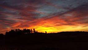 горящий восход солнца Стоковая Фотография
