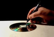 горящий компактный диск Стоковая Фотография