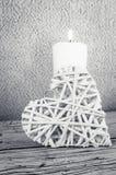Горящий символ свечи и сердца Стоковые Изображения