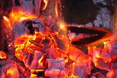 Горящий уголь на заднем плане Стоковые Фото