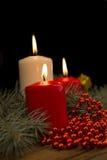 3 горящих свечи рождества на предпосылке br ели Стоковое фото RF