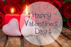 2 горящих свечи с свежими розами Стоковая Фотография