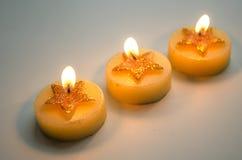 3 горя декоративных свечи с картиной звезды Стоковое фото RF