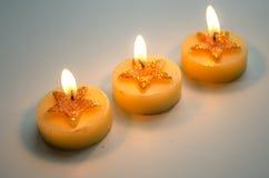 3 горя декоративных свечи с картиной звезды Стоковые Фото