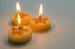 3 горя декоративных свечи с картиной звезды Стоковые Изображения