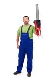 Гордый рабочий-строитель с цепной пилой Стоковая Фотография RF