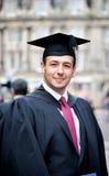 Гордый студент-выпускник Стоковые Изображения