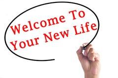 Гостеприимсво сочинительства руки к вашей новой жизни на прозрачной доске Стоковые Фотографии RF