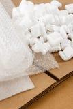 Гофрированные коробка и упаковочные материалы Стоковое фото RF