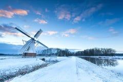Голландская ветрянка в зиме снега Стоковое фото RF