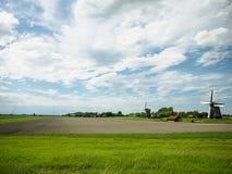 Голландские ветрянки в польдере Стоковые Фото