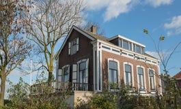 Голландский исторический дом в малой деревне Стоковое Фото