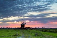 Голландская ветрянка на восходе солнца Стоковые Изображения