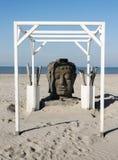 Голова Будды на пляже в Голландии Стоковая Фотография