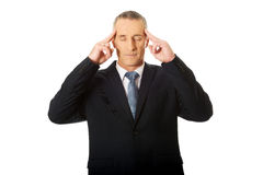 Голова задумчивого бизнесмена касающая Стоковое Изображение