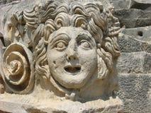Голова Медузы камн-высекаенная Gorgon в древнем городе Myra стоковое фото