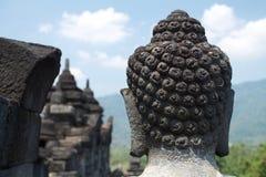 Голова статуи Будды в виске Borobudur около Yogyakarta, Стоковые Фото