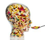Голова сделанная из стекла с таблетками Стоковые Изображения RF