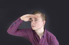 Годовалый мальчик милые 16 в студии смотря в далеко Стоковые Изображения RF