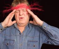 Головная боль старшего человека Стоковые Фото