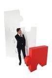 Головоломка бизнесмена собирая Стоковая Фотография RF