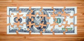 Головоломка от 100 долларовых банкнот Стоковые Изображения RF