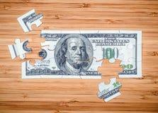 Головоломка от 100 долларовых банкнот Стоковое Фото