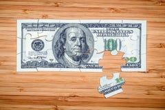 Головоломка от 100 долларовых банкнот Стоковое Изображение