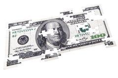 Головоломки 100 долларов на белизне Стоковые Изображения