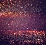 Год сбора винограда яркого блеска освещает предпосылку золото, серебр, и чернота де-сфокусированный стоковые фото