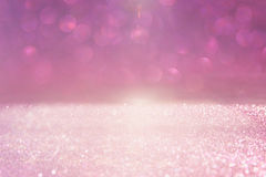 Год сбора винограда яркого блеска освещает предпосылку пинк и серебр defocused стоковое изображение