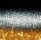 Год сбора винограда яркого блеска освещает предпосылку светлое золото и чернота defocused стоковое изображение