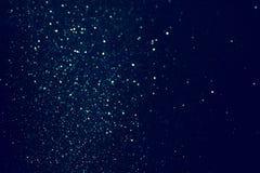 Год сбора винограда яркого блеска освещает предпосылку черная синь Сфокусированный De Стоковые Фото