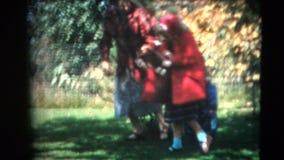 год сбора винограда 8mm - 60's семья и игра кота Стоковое фото RF
