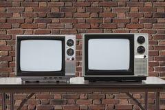 2 год сбора винограда Televisons с кирпичной стеной Стоковое Изображение