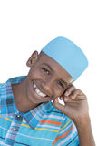 12-год-старый мальчик нося голубую изолированную шляпу, Стоковое фото RF