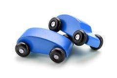 Голубая автокатастрофа игрушки против белой предпосылки Стоковые Изображения