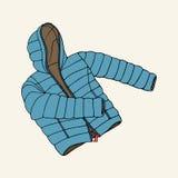 Голубая вниз куртка Стоковые Фото