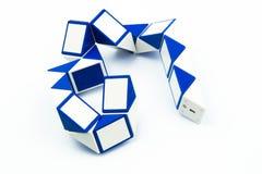 Голубая волшебная форма змейки и правителя переплетает головоломку Стоковое фото RF