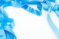 Голубая лента на белой предпосылке Стоковое фото RF