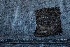 Голубая джинсовая ткань с заплатой Стоковая Фотография