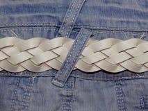 Голубая джинсовая ткань с поясом Стоковые Изображения