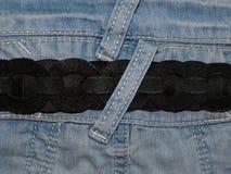 Голубая джинсовая ткань с поясом Стоковое Фото
