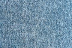 Голубая джинсовая ткань стоковые фото