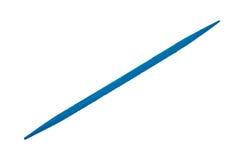 Голубая зубочистка на белой предпосылке стоковые фотографии rf