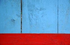 Голубая и красная деревянная предпосылка стоковые изображения