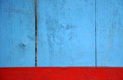 Голубая и красная деревянная предпосылка стоковое изображение rf
