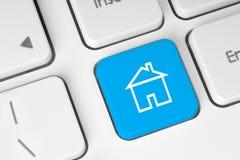 Голубая кнопка с домом Стоковые Изображения RF