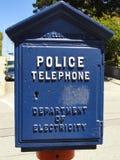 Голубая полиция знонит по телефону коробке Стоковые Фотографии RF